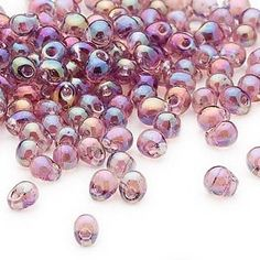 Seed bead, Miyuki, glass, clear rainbow lavender, (DP256), 4x3.4mm fringe. Sold per pkg of 10 grams.
