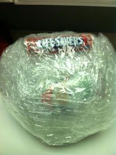 BEST Classroom Party Game EVER! These kids LOVED it! Wrap a bunch of candy in small sheets of plastic wrap until they make a huge ball...click here for more instructions.