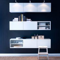 BESTÅ hvite veggskap med dører og GRUNDTAL skapbelysning i rustfritt stål