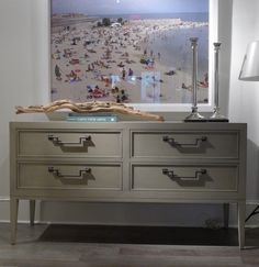 I love the clean lines of this Console Table by Thom Filicia for Vanguard Furniture.  Shown in a French Gray finish, the table would work in almost any room of the home. And isn't the hardware striking?  The large scale photograph is one of Thom's new art introductions.  Vanguard Furniture (H/W 301 N. Hamilton Street) #HPMkt