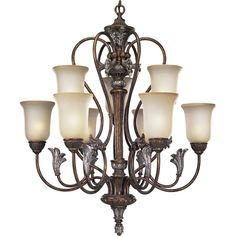 This Nine Light Up Chandelier is part of the Carmel Collection and has a Gold Finish.