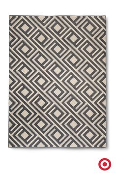 In soft neutral gray with a subtle maze design, the Threshold Square Geometric Rug coordinates with most decor. It's backed with polypropylene to stay put, and makes a comfy spot for for tummy time and playing on the floor.