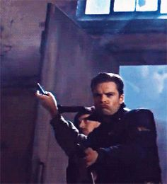 The only acceptable face to make whilst firing a weapon. << current mood : Bucky duck facing into Hydra facility Sebastian Stan, Marvel Actors, Marvel Movies, Marvel Dc, Bucky Barnes, Ben Barnes, Captain America And Bucky, Winter Soldier Bucky, British History