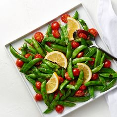 Blistered sugar snap peas with cherry tomatoes and fresh lemon juice. A perfect spring vegetable side dish. Veggie Tray, Veggie Dishes, Vegetable Recipes, Vegetarian Recipes, Healthy Recipes, Yummy Veggie, Ketogenic Recipes, Keto Recipes, Snap Peas Recipe