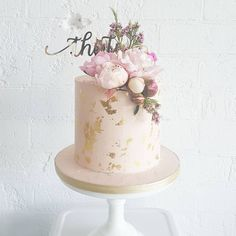 """Dusty pink buttercream finish with goldleaf, fresh blooms and a gold topper by @glisteningoccasions_ ."