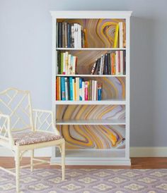 Swirls of paint dress up the plain-white back of a bookcase. More DIY furniture makeovers: http://www.midwestliving.com/homes/decorating-ideas/22-easy-furniture-makeovers/page/32/0