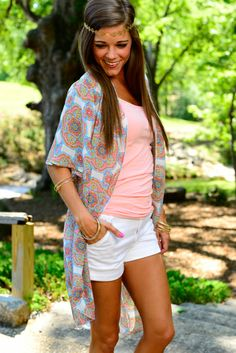 """This light cardigan is a super fun way to spice up you basic summer tanks and shorts! We love the bright colors in that kaleidoscope print! So easy to pair with anything and everything in your closet! Fits true to size. Miranda is wearing the small. Length: S- 30"""", M- 30.5"""", L- 31"""""""