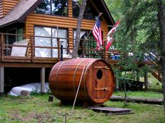 Rozycki Woodworks - Bent Stave Barrel Sauna delivered and set-up near a lake in Canada.