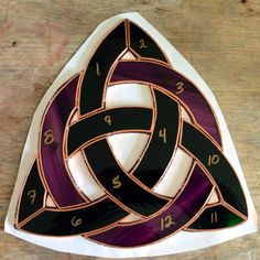 Dark green Triquetra with a medium purple with dark purple streaks circle
