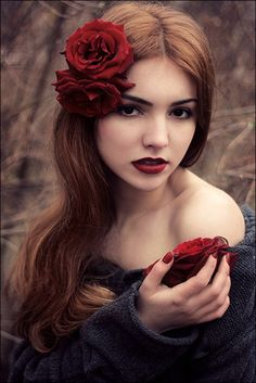 She looks like one of the Fae. redhead red rose