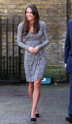 Kate Middleton shows off baby bump in a MaxMara dress in London