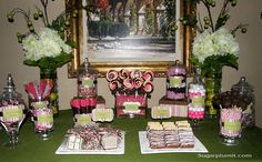 A chocolate and Pink Candy buffet..lollipop display    A chocolate and Pink Candy buffet