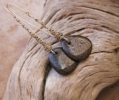 Desert Talismans. Copper Fire Brick Pendant Earrings with Sterling Silver Wire Wrap. $145.00, via Etsy.