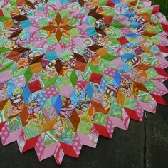 """Wowee! EPP gone crazy beautiful! squares & 8-pt diamonds make an """"elongated tumbling block""""..clever! Paperpieces.com"""