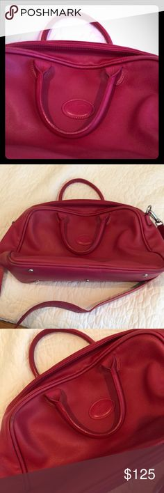 Longchamp Pink Genuine Leather Travel Bag Vintage Longchamp travel bag, with some natural wear (photos available). Still in fabulous condition, and perfect to put on top of roller suitcase. Great carryon, as well! Longchamp Bags Travel Bags