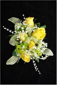Prom Flowers - Wrist Corsage of yellow roses accented with white pearl sprays and mint green ribbon.