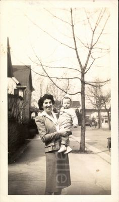 Mother Holding Child Vintage Black and White by foundphotogallery
