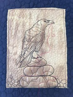 Raven with the red thread 2. Free Motion Quilted on Hand Dyed Silk. By Textile Artist and Art Quilter Cindy Watkins