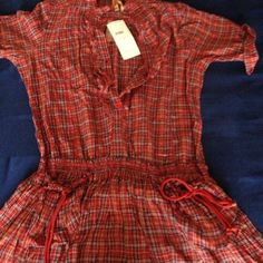 NEVER WORN - Plaid Summer Dress. BRAND NEW!  NEVER BEEN WORN. This summer dress is great to wear with leggings or shorts.  The two pockets in the front allow for your money and phone to be carried without bringing your purse to run errands. Dresses Midi