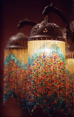 beaded home decor projects | This hanging chandelier offers a soft glow from its multicolored ...