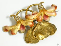 An Art Nouveau enamel and gold brooch
