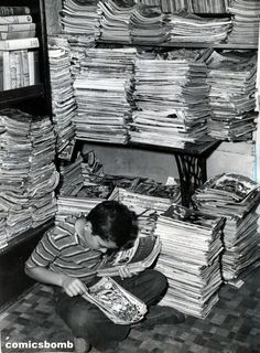 A boy doing some serious back issue comics hunting(1946).