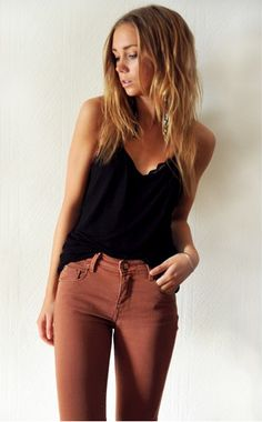 colored jeans with a black tank and lace bra underneath! love