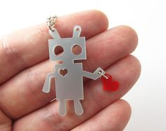 Robot Tin Man. Recreate from milk bottle plastic, hole punch and permanent markers.