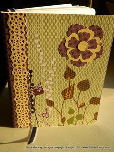 Altered 40-cent composition book using scrapbook paper