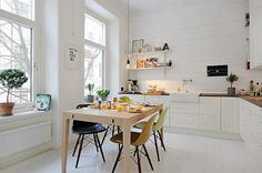 love this cool rustic modern white paneled kitchen/ dining room