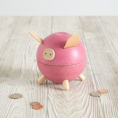 """If this piggy bank could talk, it wouldn't say, """"oink. """" It would probably say something like, """"Fiscal responsibility is important, so try storing your money inside this bank for a rainy day.  After all, loose change adds up quickly. """" Yeah, he's a pretty intelligent pig. Choose from two colorsEach bank has a slit on the back for easy coin depositCan be opened by pulling the top away from the bottomEach bank weighs 1 lb."""