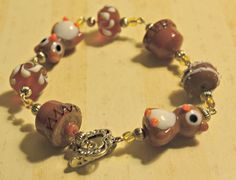 Lamp work glass Owl silver charm bracelet by TheArtsyCajun on Etsy, $21.00