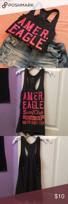 American Eagle Tank Colorful American Eagle blackish-gray tank top with orange and pink letters. Used but in good condition. Super cute and perfect for a picnic or a day at the beach. Shorts in cover photo not included. PLEASE READ THE ENTIRE DESCRIPTION BEFORE PURCHASING! 🚫 NO TRADES. NO HOLDS. NO MERC@RI 🚫📩 I only respond to offers made through the offer button 📩  🙋🏼Questions? Just ask! Serious inquiries only please. EVERYTHING MUST GO!! 💁🏼 American Eagle Outfitters Tops Tank Tops