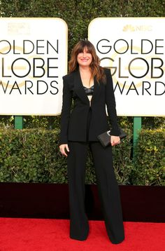 Updating: The Golden Globe Awards are taking place tonight at the Beverly Hilton in Beverly Hills, Calif. See what celebrities are wearing on the red carpet.