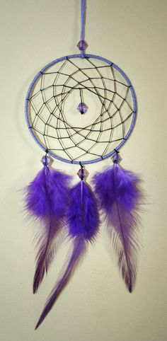 Hey, I found this really awesome Etsy listing at https://www.etsy.com/listing/183558419/purple-dreamcatcher