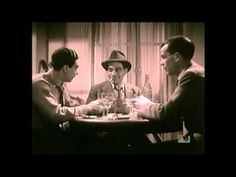 """Jazz """"Hot"""" - Django on film from the late 30s. This is great as it has the rest of the Quintet of the Hot Club of France, including his brother Joseph (on the left playing cards)."""