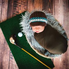 This tiny newborn is the son of an avid golfer of course! Burnt Wood Floordrop from Backdrops Canada. Photo credit goes to Lime Star Photography. Available online at www.backdropscanada.ca