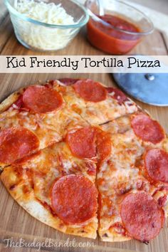 Kid Friendly Tortilla Pizza's are easy to make themselves. They require very lit… Kid Friendly Tortilla Pizza's are easy to make themselves. They require very little prep, minimum clean up required and the kids have fun making them! Baby Food Recipes, Dinner Recipes, Cooking Recipes, Healthy Recipes, Healthy Meals, Kid Cooking, Kid Recipes, Cooking Pork, Skillet Recipes