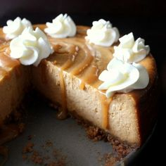 This Pumpkin Cheesecake Pie features a layer of traditional pumpkin pie on top of a rich cheesecake layer with pecan streusel.