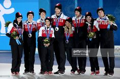 Silver medalists Kaetlyn Osmond, Patrick Chan, Kevin Reynolds, Meagan Duhamel, Eric Radford, Kirsten Moore-Towers, Dylan Moscovitch, Tessa Virtue and Scott Moir of Canada celebrate during the medal ceremony for the Team Figure Skating Overall on day 3 of the Sochi 2014 Winter Olympics at Medals Plaza in the Olympic Park on February 10, 2014 in Sochi, Russia.