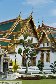 A topiary garden of sculpted living trees grows by the Phra Maha Monthian Group (Paisal Taksin Hall and Hor Phra Dhart Monthian) at the Grand Palace, in Bangkok, Thailand. The Grand Palace (Phra Borom Maha Ratcha Wang) was built on the east bank of the Chao Phraya River starting in 1782, during the reign of Rama I. It served as the official residence of the king of Thailand from the 1700s to mid 1900s.