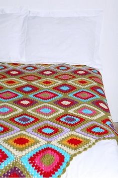 Granny square bedspread. I can just see myself wrapped up in this watching tv. :)