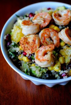 Light and healthy for summer: Quinoa, avocado, black beans corn & shrimp.  Hold the corn.