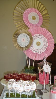 Baptism - lollipops in white crate with moss, pink lemonade jelly and crystal rock candy sticks.