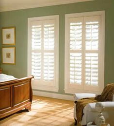 Plantation shutters.  We just put these in our bedroom & we love them so much, we going to put them in the rest of the house.  No fabric treatment needed.