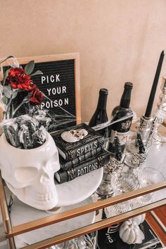 How to design the perfect Halloween bar cart with a few simple tips | Halloween bar cart decor, Halloween bar cart ideas #barcart #halloweendecor Wine Glass Set, My Glass, Candy Display, Pick Your Poison, Bar Cart Decor, Big Bottle, My Bar, Taper Candles