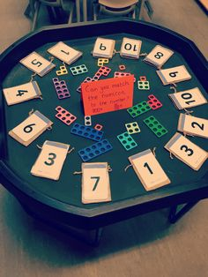 Match the numicon to the number bag and pop it inside!! #tufftray #toughspot #eymaths #eyfs #provision #blacktray