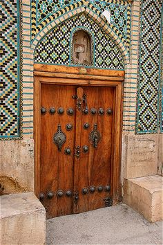 Ornate door with male and female knockers
