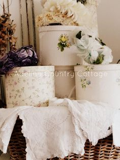 shabby chic hat boxes ~~~~~ no tutorial but just purchase old large boxes and redo in your own choice of wallpaper :)