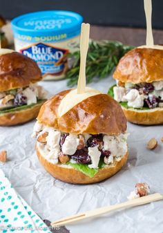 Lighter Sonoma Almond Chicken Salad Sliders are slider rolls filled with a creamy, lightened up Greek Yogurt chicken salad that's a healthier option for parties and Game Day! Via @FlavortheMoment